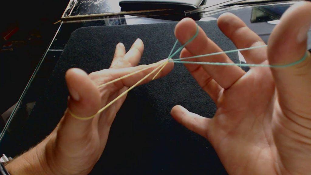 tour de magie - fusionner deux élastiques